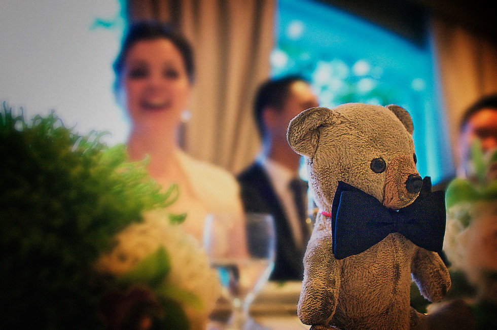 The bride's childhood teddy bear was adorned by her father with a bow tie, and presented during a speech.