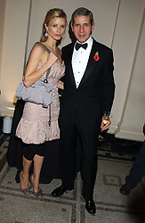 LAURA BAILEY and STUART ROSE at the 2005 British Fashion Awards held at The V&A museum, London on 10th November 2005.<br />