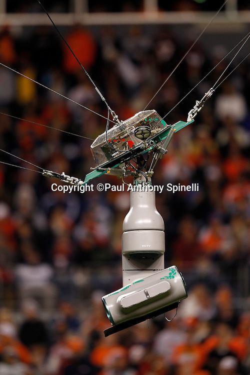 An overhead television camera shoots the Denver Broncos NFL week 11 football game against the New York Jets on Thursday, November 17, 2011 in Denver, Colorado. The Broncos won the game 17-13. ©Paul Anthony Spinelli