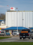"20 APRIL 2020 - PERRY, IOWA:  The main entrance to the Tyson Foods pork processing plant in Perry, IA. The Tyson pork processing plant in Perry reported over the weekend that at least two dozen workers had tested positive for COVID-19. The plant is closed Monday, April, 20 for a thorough cleaning and sanitization. At least five meat packing plants in Iowa have reported outbreaks of COVID-19. In addition to the five plants in Iowa, meat packing plants close to Iowa in Nebraska, South Dakota, and Minnesota have reported outbreaks of COVID-19 (SARS-CoV-2, Coronavirus). The Tyson plant has more than 1,400 workers and is the largest single employer in Perry. The state of Iowa has begun providing surveillance testing of meatpacking plants to more broadly test employees even if they are not experiencing symptoms of COVID-19. State ""strike teams"" made up of an epidemiologist, an infectious disease nurse and other personnel will advise facilities of preventative measures to take and administer contact tracing to determine who may have been in contact with any infected individual. The state of Iowa has begun providing surveillance testing of meatpacking plants to more broadly test employees even if they are not experiencing symptoms of COVID-19. State ""strike teams"" made up of an epidemiologist, an infectious disease nurse and other personnel will advise facilities of preventative measures to take and administer contact tracing to determine who may have been in contact with any infected individual.     PHOTO BY JACK KURTZ"