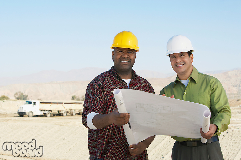 Two Construction Workers on Site