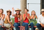 Cowgirls cheers at Miles City Bucking Horse Sale and rodeo in Miles City Montana