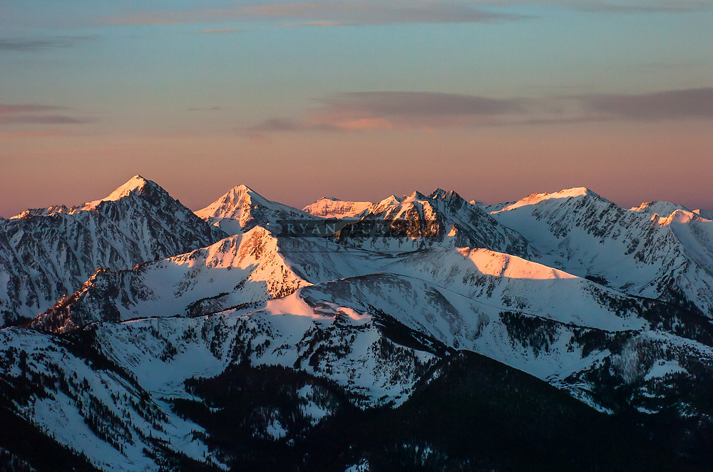 Lone Peak and the Madison Range in alpenglow light.
