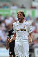 New Swansea city signing Michu © shows his early commitment to his new club as he celebrates winning a corner. Pre-season friendly match, Swansea city v FC Stuttgart at the Liberty Stadium in Swansea, South Wales on Saturday 11th August 2012. pic by Andrew Orchard, Andrew Orchard sports photography,