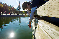Nicolaus Brown, 12, watches his hook and bait drift under the surface of Fernan Lake while fishing with a short length of line during an outing Monday with his outdoors sport class from Lakes Magnet Middle School. The students studied knot tying, fish identification, rules and regulations before setting out to the shoreline to try their luck at the sport.