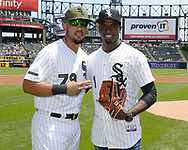 CHICAGO - MAY 27:  Cuban outfielder Luis Robert and first baseman Jose Abreu #79 of the Chicago White Sox pose for a photo prior to the game against the Detroit Tigers on May 27, 2017 at Guaranteed Rate Field in Chicago, Illinois.  Robert, 19, has played the last four seasons (2013-16) for Ciego de Ávila in the Cuban Serie Nacional (Cuban National Series), Cuba's top-level league. The 6-foot-2, 210-pound Robert made his debut with the team in 2013 at age 16. Robert played for Cuba's U-18 National Team from 2014-2015, making appearances at the World Cup (2015) and Pan American Games (2014). He was teammates with White Sox and baseball's No. 1 overall prospect Yoán Moncada in 2014. Robert also played for Cuba's U-15 National Team in 2012.Robert played for Cuba's U-18 National Team from 2014-2015, making appearances at the World Cup (2015) and Pan American Games (2014). He was teammates with White Sox and baseball's No. 1 overall prospect Yoán Moncada in 2014. Robert also played for Cuba's U-15 National Team in 2012.  (Photo by Ron Vesely/).  Subject:Luis Robert; Jose Abreu