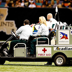 Oct 24, 2010; New Orleans, LA, USA; A member of the chain gang injured in a sideline collision is taken off the field on a stretcher during the second half of a game between the New Orleans Saints and the Cleveland Browns at the Louisiana Superdome. The Browns defeated the Saints 30-17.  Mandatory Credit: Derick E. Hingle