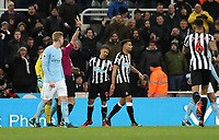 Football - 2017 / 2018 Premier League - Newcastle United vs. Manchester City<br /> <br /> Dwight Gayle of Newcastle United is booked for diving at St James' Park.<br /> <br /> COLORSPORT/LYNNE CAMERON