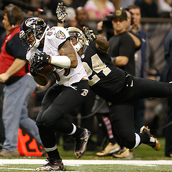 Nov 24, 2014; New Orleans, LA, USA; Baltimore Ravens wide receiver Steve Smith (89) catches a pass over New Orleans Saints cornerback Corey White (24) during the first quarter of a game at the Mercedes-Benz Superdome. Mandatory Credit: Derick E. Hingle-USA TODAY Sports