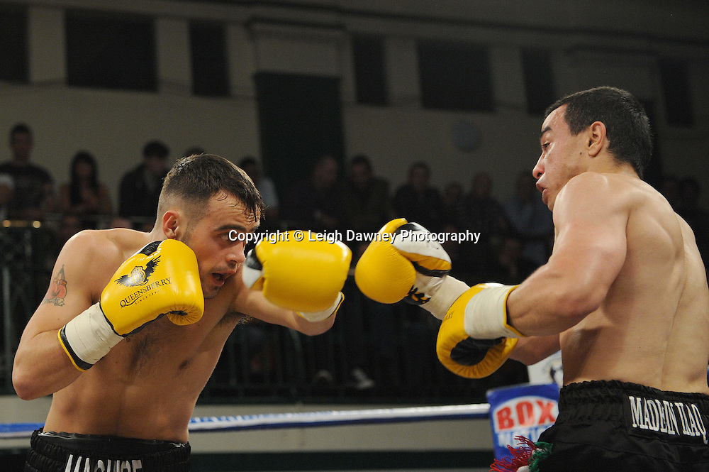 Najah Ali (black shorts) defeats Michael McGuire in a 6x3 min Super Bantamweight contest at York Hall, Bethnal Green, London on Friday 13th January 2012. Queensbury Promotions © Leigh Dawney 2012