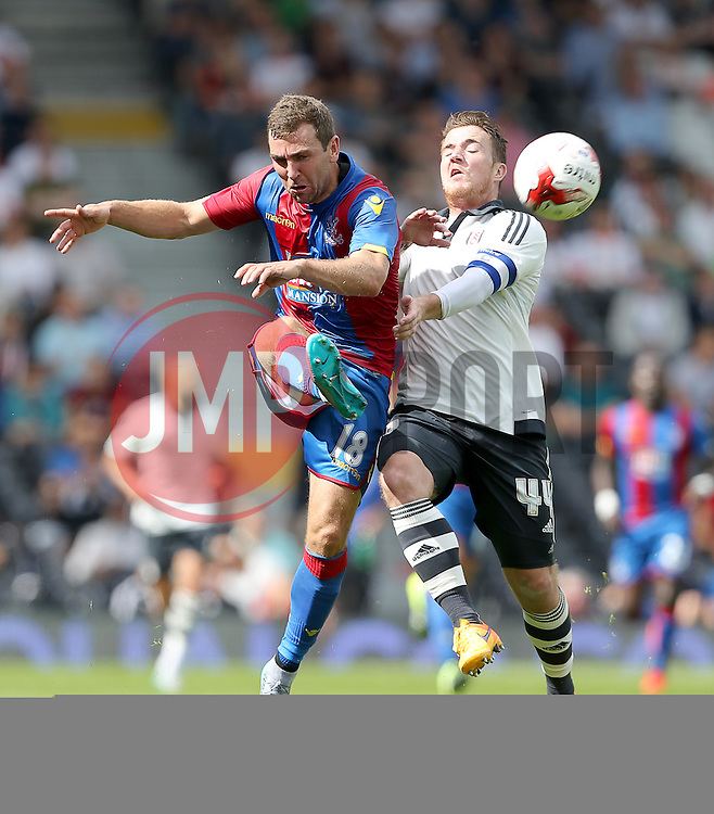 Ross McCormack of Fulham and James McArthur of Crystal Palace challenge for the ball - Mandatory by-line: Paul Terry/JMP - 07966386802 - 01/08/2015 - SPORT - FOOTBALL - Fulham,England - Craven Cottage - Fulham v Crystal Palace - Pre-Season Friendly