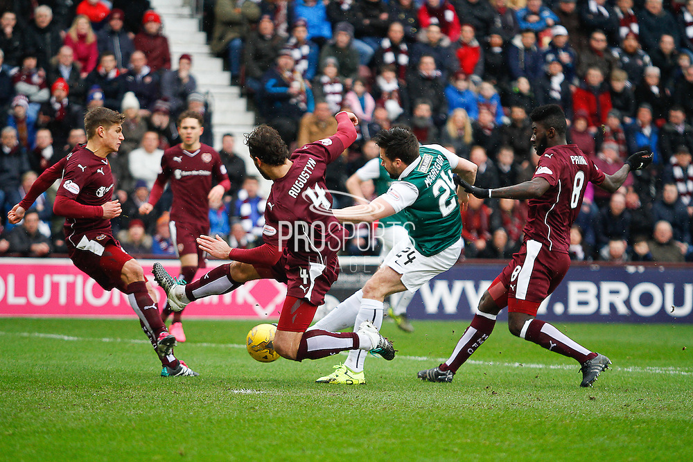 Hibernian FC Defender Darren McGregor getting the shot away during the Scottish Cup 5th round match between Heart of Midlothian and Hibernian at Tynecastle Stadium, Gorgie, Scotland on 7 February 2016. Photo by Craig McAllister.