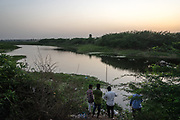 People fish by a lake in Waragal, Telangana, Indiia, on Saturday, February 9, 2019. Photographer: Suzanne Lee for Safe Water Network