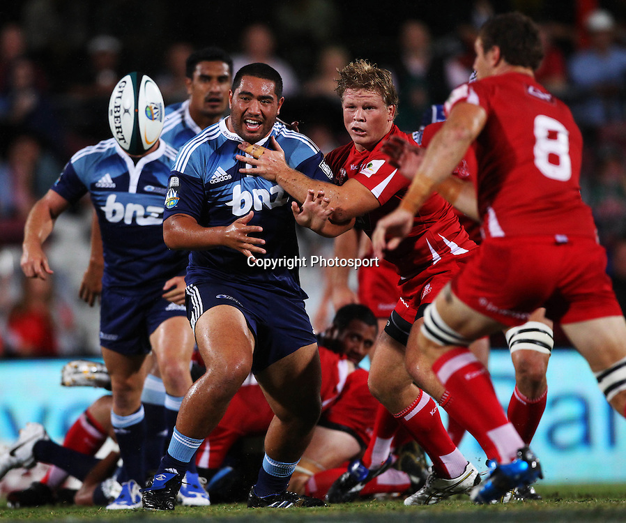 Charlie Faumuina gets a pass away during the Super 14 rugby union match between the Reds and the Blues at Ballymore, Brisbane, Australia. Rebel Sport Super 14. Saturday 27 February 2010 . Photo: Patrick Hamilton/PHOTOSPORT
