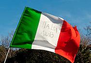 Roma, 6 Gennaio  2013..Manifestazione contro l'ipotesi della discarica a Monti dell'Ortaccio, dei cittadini di Valle Galeria, zona  dove è situata la  mega-discarica di Malagrotta. La bandiera italiana con scritto: Italia Aiuto..Rome, January 6, 2013..Demonstration against the hypothesis of the landfill to Monti dell'Ortaccio,of the  citizens of Valle Galeria area, an area that is already located the mega-landfill Malagrotta. The Italian flag with the word: Italy Help..