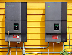 17 July 2013. New Orleans, Louisiana.<br /> Photo Voltaic (PV) Inverters convert DC to AC power, hooked into the power grid returning energy to the house and to Entergy as the house goes solar. Solar panels adorn the roof courtesy of Uptown Solar and a tax credit from the state and federal government.<br /> Photo; Charlie Varley