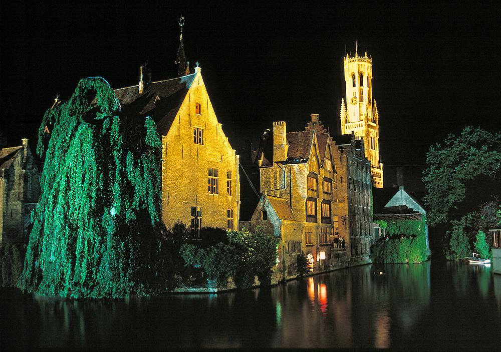 Details of the flood-lit buildings highlight an evening walk in Bruges, Belgium.