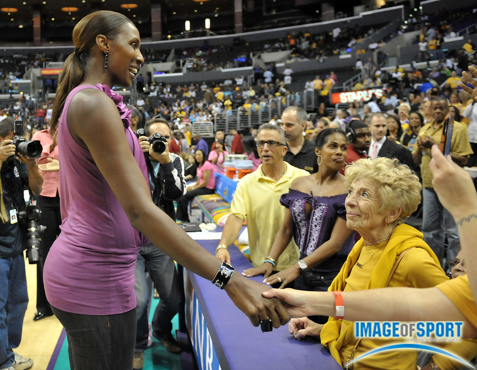 Aug 10, 2010; Los Angeles, CA, USA; Los Angeles Sparks former player Lisa Leslie is greeted by fans after a halftime ceremony to retire the No. 9 jersey of Leslie during the WNBA game against the Indiana Fever at the Staples Center. Photo by Image of Sport