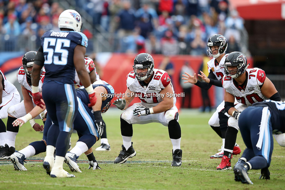 Atlanta Falcons guard Andy Levitre (67) pass blocks along side Atlanta Falcons offensive tackle Jake Matthews (70) during the 2015 week 7 regular season NFL football game against the Tennessee Titans on Sunday, Oct. 25, 2015 in Nashville, Tenn. The Falcons won the game 10-7. (©Paul Anthony Spinelli)