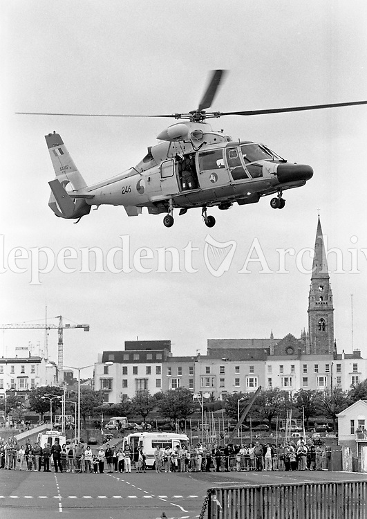 An Aer Corps Dauphin 2 Helicopter takes-off  from Dún Laoghaire Pier, during a Dept of Marine Emergency Rescue Service demonstration, 23/06/1996 (Part of the Independent Newspapers Ireland/NLI Collection).
