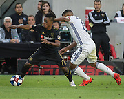 LAFC forward Latif Blessing (7) and FC Dallas midfielder Bryan Acosta (8) in action during a MLS soccer match against the FC Dallas in Los Angeles, Thursday, May 16, 2019. LAFC defeated FC Dallas 2-0.  (Ed Ruvalcaba/Image of Sport)