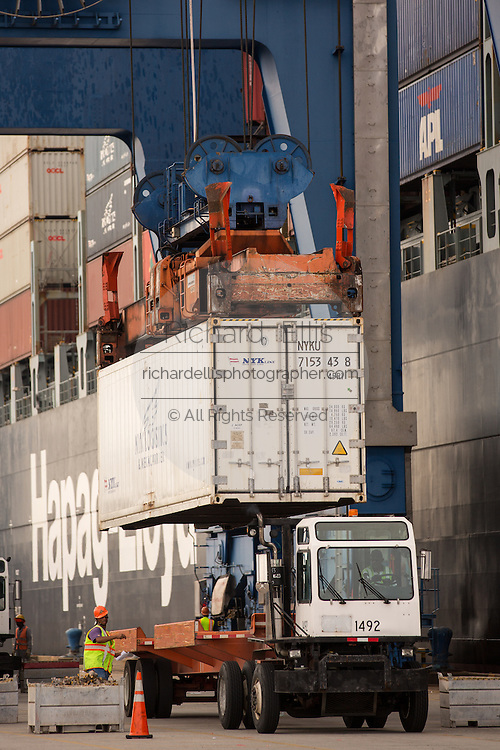 Workers unload three container ships at Charleston Ports Wando Welch Terminal on September 16, 2013 in Mt Pleasant, South Carolina.