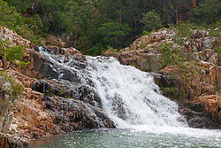 A small waterfall flows into Dugong Bay on the Kimberley coast after two concurrent cyclones bring torrential rain to the region.