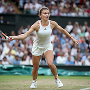LONDON, ENGLAND - JULY 11:  Simona Halep of Romania in action against Johanna Konta of Great Britain in the Ladies' Singles Quarter Final match on Center Court during the Wimbledon Lawn Tennis Championships at the All England Lawn Tennis and Croquet Club at Wimbledon on July 11, 2017 in London, England. (Photo by Tim Clayton/Corbis via Getty Images)