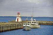 Lighthouse, wharf and boats<br /> Belliveau Cove<br /> Nova Scotia<br /> Canada