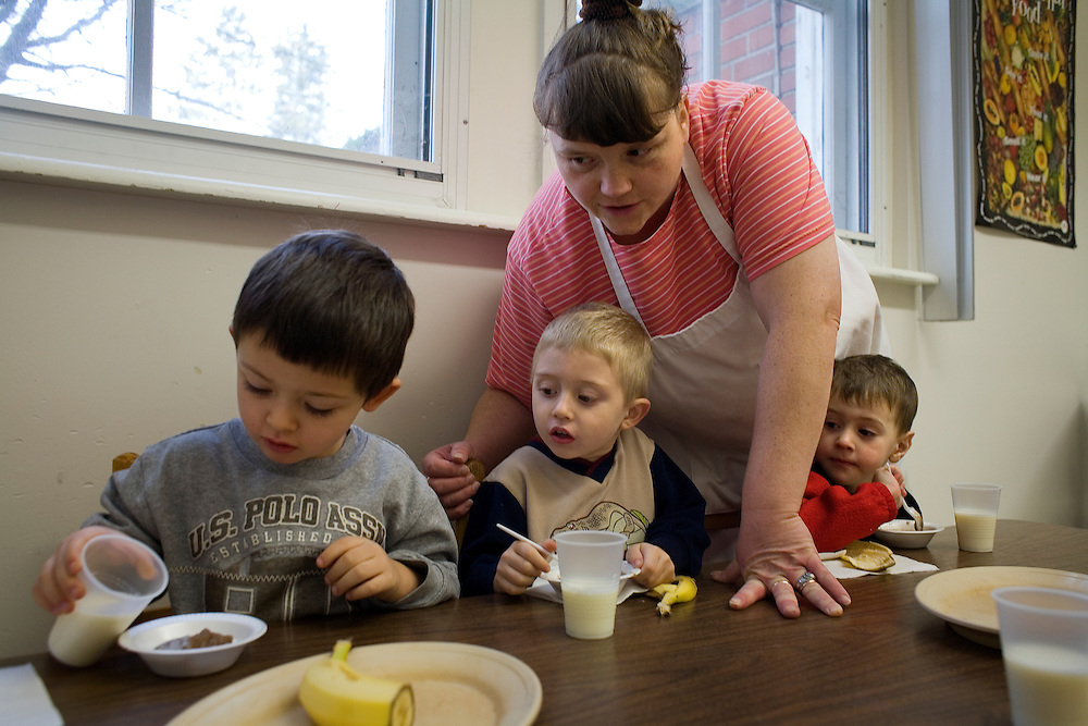 Garret County Community Action Non-Profit...Michele Howser, Head Start Cook, helps pre-school children with their breakfast at the Oakland Head Start Program located at 104 E. Center Street, Oakland, Md 21550...Images of Head Start Program - A positive learning environment and developmentally appropriate experiences are provided to children 3 to 5 years of age at 10 locations throughout Garrett County.