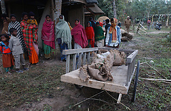 The family of a woman who was killed by a wild elephant mourns her death in a village outside of Tezpur, Assam December 28, 2003. (Ami Vitale)