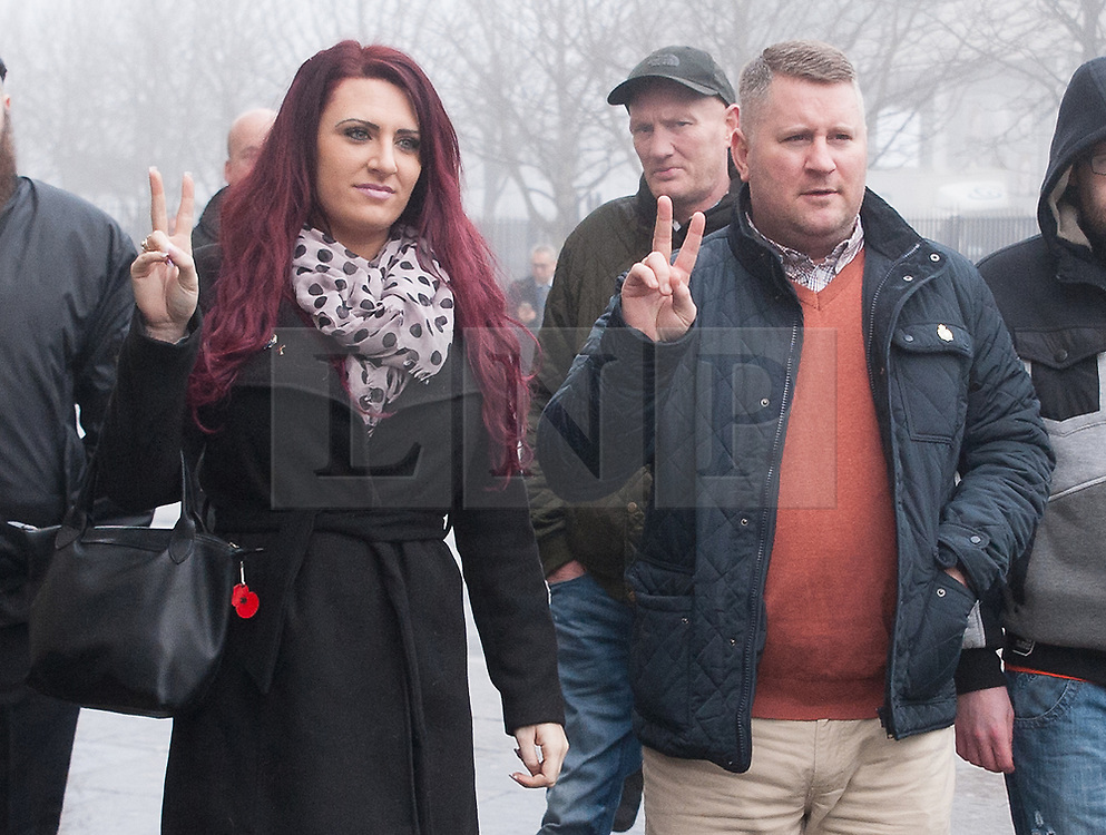 """© Licensed to London News Pictures. 10/1/2018. Belfast, UK. Britain First's leader Paul Golding (R) with deputy leader Jayda Fransen (L) arrives at court to make his first appearance after being charged with using """"threatening, abusive, insulting words or behaviour"""" following a speech he gave at a rally organised by Independent Belfast City Councillor Jolene Bunting last year. Ms Fransen has been criticised after appearing in a video showing her sitting in robes in the Lord Mayor's chair inside Belfast City Hall. The council are investigating.   Photo credit: John Rymer/LNP"""