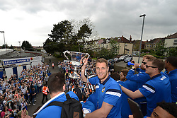 Bristol Rovers' Lee Brown poses with the Vanarama Conference Play-Off Final trophy - Photo mandatory by-line: Dougie Allward/JMP - Mobile: 07966 386802 - 25/05/2015 - SPORT - Football - Bristol - Bristol Rovers Bus Tour