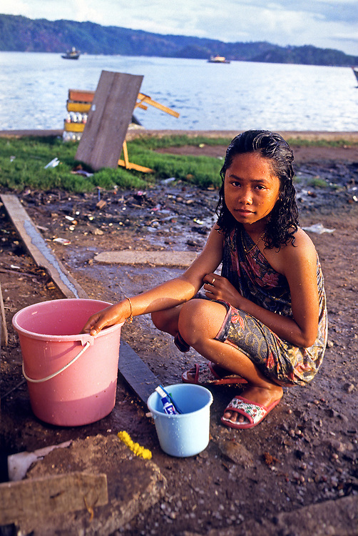 Young girl washing, Borneo, Malaysia, SE Asia