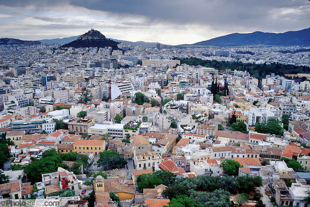 From atop the Acropolis in Greece, see central Athens, including: Plaka (the old Turkish quarter), Syntagma (central business district), and Lykavittos Hill (highest point in Athens). The Acropolis of Athens and its monuments were honored as a UNESCO World Heritage Site in 1987.