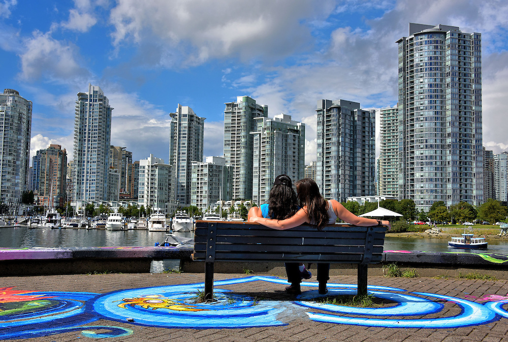 Romantic Couple on Bench Viewing Downtown Vancouver, Canada | Encircle Photos