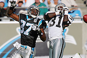 CHARLOTTE, NC - NOVEMBER 7:  Cornerback Phillip Buchanon #31 of the Oakland Raiders nearly intercepts a pass intended for wide receiver Mushin Muhammad #87 of the Carolina Panthers at Bank of America Stadium on November 7, 2004 in Charlotte, North Carolina. The Raiders defeated the Panthers 27-24. ©Paul Anthony Spinelli  *** Local Caption *** Phillip Buchanon;Mushin Muhammad
