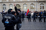 """An anti-fascist is pushed back by police officers from disturbing a rally of about 40 activists of islamophobic group """"Freie Buerger fuer Frankfurt"""" (formerly PEGIDA) in the german city of Frankfurt."""