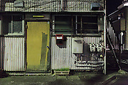 old decaying building in residential neighborhood Japan