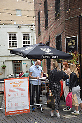 Easing of Coronavirus lockdown on 4 July 2020 in Norwich, UK. Pubs, restaurants, hairdressers etc are finally allowed to open, with social distancing. Pub visitors have to leave their personal details for contact & trace