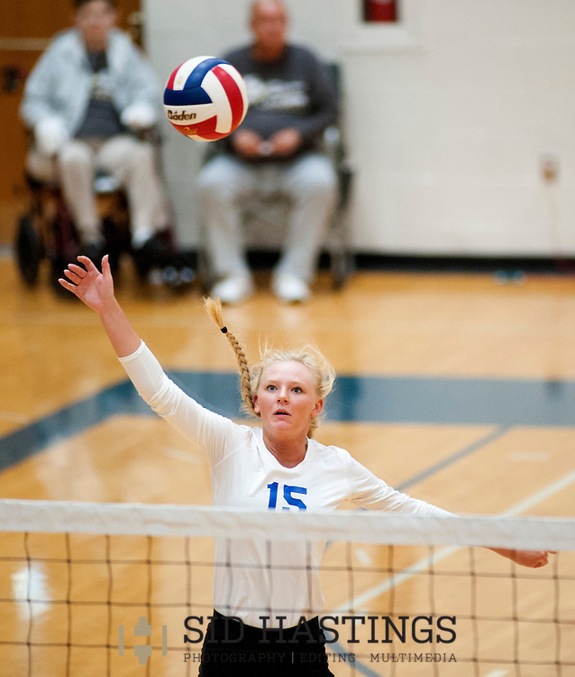 25 AUG. 2015 -- ST. CHARLES, Mo. --Duchesne High School volleyball player Natalie Schroeder (15) leaps to return a shot against St. Pius X High School at Duchesne in St. Charles, Mo. Tuesday, Aug. 25, 2015. St. Pius won, 2-0 (25-14, 25-23), to advance to 6-0. It was Duchesne's first match, dropping them to 0-1 on the year. Photo © copyright Sid Hastings.