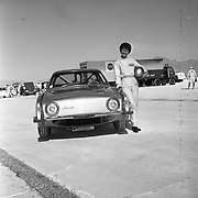 Driver Paula Murphy poses with the #9 Studebaker Avanti at the Bonneville Salt Flats in October of 1963.