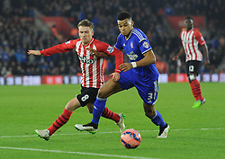 Southampton's Steven Davis and Ipswich Town's Tyrone Mings chase the ball - Photo mandatory by-line: Paul Knight/JMP - Mobile: 07966 386802 - 04/01/2015 - SPORT - Football - Southampton - St Mary's Stadium - Southampton v Ipswich Town - FA Cup Third Round
