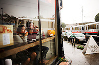 The N-Judah runs past the Trouble Coffee Company in San Francisco's far western neighborhood, the Outer Sunset, on Sunday, Oct. 24, 2010.