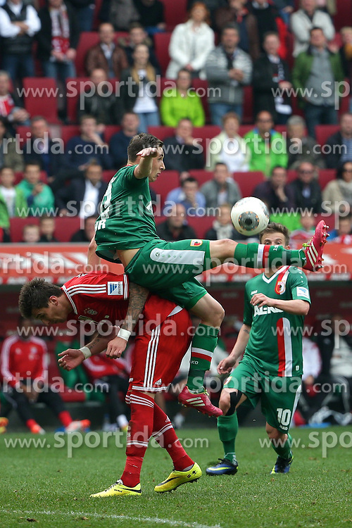 05.04.2014, SGL Arena, Augsburg, GER, 1. FBL, FC Augsburg vs FC Bayern Muenchen, 29. Runde, im Bild Augsburgs Dominik Kohr (# 21, FC Augsburg) gegen Mario Mandzukicv (# 9, Bayern Muenchen) oben auf // during the German Bundesliga 29th round match between FC Augsburg and FC Bayern Munich at the SGL Arena in Augsburg, Germany on 2014/04/05. EXPA Pictures &copy; 2014, PhotoCredit: EXPA/ Eibner-Pressefoto/ Fastl<br /> <br /> *****ATTENTION - OUT of GER*****