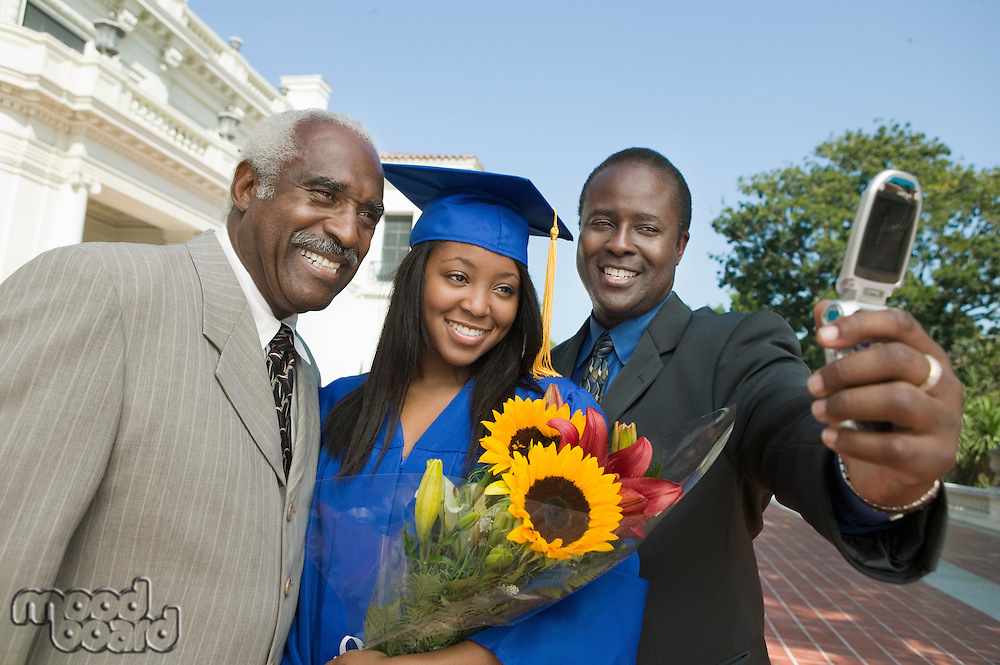 Graduate Taking Pictures with Father and Grandfather