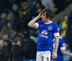 NORWICH, ENGLAND - Saturday, February 23, 2013: Everton's Leighton Baines looks dejected as Norwich City score an injury time winning goal during the Premiership match at Carrow Road. (Pic by David Rawcliffe/Propaganda)