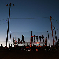 Lauren Wood   Buy at photos.djournal.com<br /> Fans stand on the baseball diamond stands overlooking the softball stadium to watch Tuesday night's 3A softball semifinal game where Mooreville played host to Nettleton.