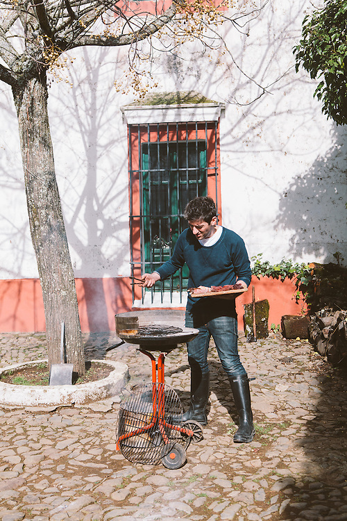 Chef/Director of The Salt Yard Group, Ben Tish, cook cuts of Iberico Pork in Extramedura, Spain.