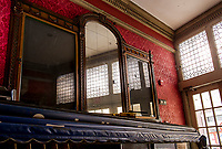Renovation work done by Bonnette, Page and Stone at the Colonial Theater in downtown Laconia. Original wallpaper / woodwork around mirrors at the entrance of the Lobby.   ©2016 Karen Bobotas Photographer
